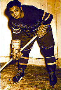 Larry Kwong, with the New York Rangers.